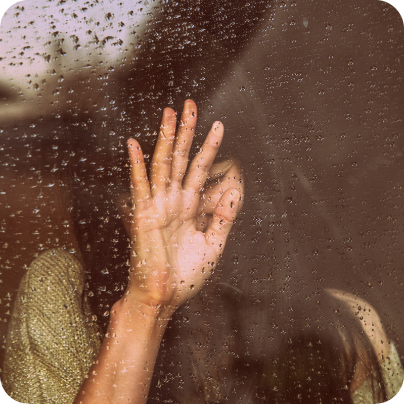 Girl Behind Wet Window - Milada Vigerova